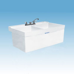 Mustee - Mustee 26W Double Basin Wall Mount Utility Sink - 26W - Shop for Commercial Laundry and Utility from Hayneedle.com! The Mustee 26W Double Basin Wall Mount Utility Sink is a wall-mounted unit that makes a perfect complement or alternative to your washer/dryer units. Two 13-inch deep 19-gallon capacity tubs are joined by a molded divider and made from white thermoplastic Durastone resin with an integrated leak-proof drain (with stopper); Durastone is a blend of fiberglass resin and stone that's naturally resistant to mold and mildew. The mounting bracket side supports and hardware for installing the unit are all included. Unit is fitted for a 4-inch diameter drain (not included).About Trumbull IndustriesFounded in 1922 as a single branch plumbing supply house Trumball Industries has evolved over the years in to a privately held corporation and full-line distributor with specialized divisions. With 6 branch locations Trumball Industries has several divisions: an Industrial Division that provides products and services to industrial manufacturers a Home Center Division that offers expertise in all major kitchen and bath products a Municipal Division that offers a full line of water and sewer products and a Master Distribution Center with 500 000 square feet housing over 80 000 products. Aside from providing quality services to their customers the people at Trumbull Industries are happy provide a tour of any of their facilities as well as assist you with any design layout or purchasing decisions.