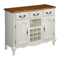 HomeStyles - Oak and Rubbed White Buffet - The buffet is constructed of hardwood solids and engineered wood in a distressed oak and heavily rubbed white finish showcasing a bit of base coat providing a weathered look. The oak top features several distressing techniques such as worm holes, fly specking, and small indentations. Additional features include three storage drawers, two storage doors with adjustable shelves, removable wine rack, and one center fixed shelf. Beautifully accented with shaped, carved proud legs, corner peg accents, and detailed brass hardware. Assembly required. 44.25 in. W x 17.5 in. D x 36 in. H