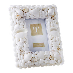 Coquillage Photo Frame - 4 x 6 - A dense collection of beautiful white seashells gives body and dimension to the Coquillage 4x6 Photo Frame. Capturing coastal memories both in the enclosed artwork and in the memories encapsulated by each hand-placed shell, the traditional seashell picture frame coordinates with each room where you place itan instant heirloom with a timeless seaside theme.