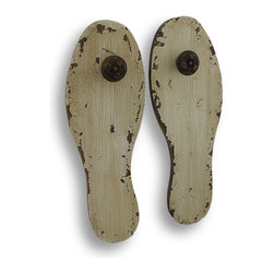 Shabby Chic Wooden Shoe Sole Wall Pegs - Add a unique accent to your home or office with this pair of wooden wall hooks. They are shaped like shoe soles and have a distressed, antique white finish with decorative wooden pegs. Each plaque measures 10 3/4 inches tall, 3 3/4 inches wide, and 1 1/2 inches deep. They are perfect for hanging lightweight items, and they look great side by side or staggered.