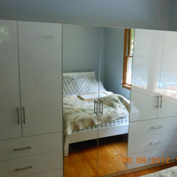 Mirrored Wardrobe Armoire - Three individual cabinets are combined to make one large six drawer wardrobe armoire.