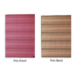 Design Within Reach - Two Ways Mat, Pink | Design Within Reach - This reversible rug woven from paper yarn allows you to switch up the color scheme of a space depending on your mood. One side is a vibrant pink, and the opposite side is neutral with pink accents.
