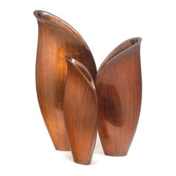 Hebi Arts 15.25 - 21.75 in. Esin Vases - Set of 3 - Placed together, the Hebi Arts 15.25 - 21.75 in. Esin Vases - Set of 3 create a blooming flower petal-like presentation. Finished in a rich, dark mocha, these splendid vases are handcrafted from wood fiber and cast in steel for a lustrous look that demands attention from onlookers. The lines are fluid and vivid, with just the right amount of sheen. They're perfect for dressing up any room, whether that is in your home or at the office.About Hebi ArtsWhen Theresa and Daryl Wong were looking for decorative pieces for their San Francisco Bay area home, they were disappointed in the prevailing aesthetic that they found. Having been born and raised in Beijing, Theresa had an appreciation for Asian art and had been exposed to a wide variety of art forms, including ones involving ancient craft techniques. So together the Wongs formed Hebi Arts with the motto of Transcending the Traditional as their mission statement. Since then, the Wongs have been working directly with designers on both sides of the Pacific Ocean to create exclusive lines of wall art, sculpture, home accessories and accent furniture.Today, through an artistic amalgam of contemporary designs, venerable aesthetics, fine craftsmanship, and undeniable elegance, Hebi Arts provides the means for discerning individuals to artistically distinguish their modern homes. Featured are museum-quality art pieces both highly collectible and attainably priced. Interior designers and specialty retailers purchase directly from the company, primarily as the result of introductions at major trade shows throughout the United States. Incidentally, the Wongs won an award for their debut exhibit in San Francisco and gained admission in their first year to the prestigious New York International Gift Show. Soon thereafter, they added Gump's and Neiman Marcus to their growing list of distinguished retailers.