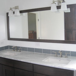 Contemporary Bathroom Remodel - Carrera Marble countertop, glazed white ceramic walls and a charcoal porcelain tile floor.