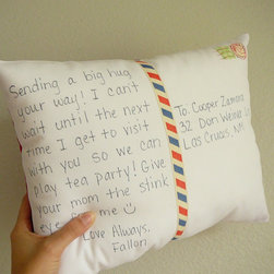 Personalize a Postcard Pillow by Olive Handmade - Look closer: this is actually a custom postcard on a pillow! What a fantastic gift for a housewarming or a far-flung friend.
