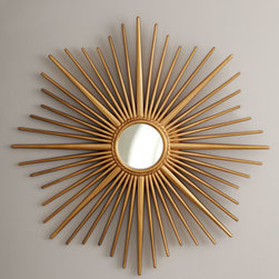 "Horchow - Golden Sunburst Mirror - A small round mirror resides inside the brilliant rays of this sunburst-framed mirror. Made of resin and mirrored glass. Hand-painted golden finish. 34""Dia. x 1""D. Imported. Boxed weight, approximately 12 lbs. Please note that this item may requ..."