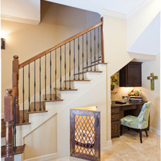Rustic Staircase by By Design Interiors, Inc