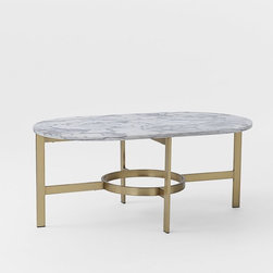 Marble Oval Coffee Table - Marble and antiqued brass are a match made in heaven, and this table would look fantastic alongside some night-sky blues and glittering star silvers.