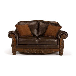 Millwood by ivgStores - Leather Loveseat w Wood Trim - North Sea Coll - Bring a timeless design to your favorite reading area, den and more. This loveseat is luxuriously appointed with rich, dark brown leather upholstery and ornate carvings along skirt and arm fronts Collection: North Sea. Material: Leather. Color/Finish: Dark Brown. Frames have been tested to GSA government standards. Corners are glued, blocked and stapled. Seats and back spring rails are cut from 7/8'' hardwood. Stripes and patterns are match cut. All fabrics are pre-approved for wearability and durability against AHFA standards. Cushion cores are constructed of low melt fiber wrapped over high quality foam. 69 in. W x 39 in. L x 42 in. H