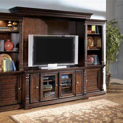 Millwood by ivgStores - Traditional Entertainment Center - TV Stand w - Made with select veneer, Ash swirl accents and hardwood solids. Dark brown gently distressed finish. Dark bronze color hardware. Framed louver look door panels. Piers come with optional speaker cloth door panel inserts. Lighted piers. Adjustable shelves.. Color: Dark Brown. TV Stand: 64 in. W x 21 in. D x 31 in. H. Right Pier: 27 in. L x 17 in. W x 76 in. H (148 lbs). Left Pier: 27 in. L x 17 in. W x 76 in. H (148 lbs). Bridge/Back Panel: 79 in. L x 16 in. W x 6 in. H (68 lbs)