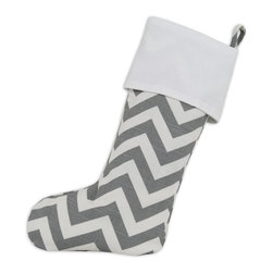"""Chooty & Co. - Gray and White Chevron Christmas Stocking with Optional Personalization - TT1930 - Shop for Holiday Ornaments and Decor from Hayneedle.com! Holiday decor meets the latest in pattern and color trends with the Chooty & Co. Gray and White Chevron Christmas Stocking with Optional Personalization. With a gray and white chevron exterior and a lined interior this stocking can be personalized with up to nine characters. Put your loved one's name on it in coordinating silver thread for a special gift. About Chooty & Co.A lifelong dream of running a textile manufacturing business came to life in 2009 for Connie Garrett of Chooty & Co. This achievement was kicked off in September of '09 with the purchase of Blanket Barons well known for their imported """"soft as mink"""" baby blankets and equally alluring adult coverlets. Chooty's busy manufacturing facility located in Council Bluffs Iowa utilizes a talented team to offer the blankets in many new fashion-forward patterns and solids. They've also added hundreds of Made in the USA textile products including accent pillows table linens shower curtains duvet sets window curtains and pet beds. Chooty & Co. operates on one simple principle: """"What is best for our customer is also best for our company."""""""