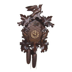 Schneider Cuckoo Clocks - 8-Day Cuckoo Clock in Antique Finish - Carved style. 8-day rack strike movement. One door. Cuckoo calls and strikes every half and full hour. Wooden cuckoo, dial with roman numerals and hand. Shut-off lever on left side of case, silences the strike, call and music. Manual shut-off lever. Made from wood. Made in Germany. 11.42 in. W x 6.69 in. D x 15.75 in. H (15.87 lbs.). Care Instructions