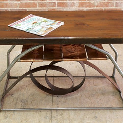 Abstract Desk - Hand crafted by our talented welder, this copper and steel coffee table is as functional as it is decorative. Created from old pine, copper and steel this handsome little table is 38″l x 18″w x 22″ high and can be customized to your liking. Call for quote.