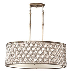 Lucia Burnished Silver Three-Light Oval Drum Pendant - Drum pendants in crystal or natural finishes will be the source of lighting for many spaces this year. I love the look of these over dining room tables or kitchen eating areas.