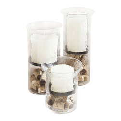 "Wine/Cork Hurricane Candle Centerpiece-Kitira - These three hammered glass hurricanes filled with decorative wine corks will look good in a kitchen or as part of any bar. With these elegant wine themed glass hurricanes and candles; your friends won""t be the only thing getting lit at your bar this year. If you pair this gift with a wine bottle you""ve got the perfect accent for any wine lover""s decor. You will notice a sleek gunmetal tray that separates the corks from the candles. The candles are beautiful Vance Kitira designer candles; which are synonymous with luxury."