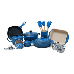 Le Creuset - Le Creuset 18 Piece Enameled Cast Iron and Stoneware Cookware, Marseille Blue - Combining the most colorful cookware with durable cast iron and stoneware, this Le Creuset 18 piece cookware set will add beauty and functionality to your kitchen. This set features Le Creuset's iconic enameled cast iron 3.5 quart round French oven, as well as a covered 1.75 quart saucepan and a 9 inch skillet. Bake with quality stoneware, including a covered 2.1 quart round casserole dish and a 1.8 quart rectangular baking dish, as well as a set of two covered mini cocottes. Continue cooking with the five essential silicone utensils and stoneware utensil storage crock. As an added bonus, this set includes a free set of stainless steel measuring cups and a set of spoons to keep your measurements precise.Perfect for locking in flavor and keeping foods moist and tender, each piece of enameled cast iron is made with an exterior that resists chipping and cracking. The French oven and saucepan each include a lid that traps in heat and moisture for more thorough cooking and full-flavored meals. Each lid also features a phenolic knob that can withstand temperatures of up to 500 degrees Fahrenheit. The skillet features handy pour spouts and a black interior that requires no seasoning, making it ready for use right out of the box. With large helper handles, these enameled cast iron pieces are perfect for moving from stove to tabletop for easy serving. Bake up perfectly cheesy lasagna, oven-roasted chicken, and more with the round casserole dish and rectangular baking dish.