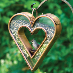 Grandin Road - Fly-Thru Heart Bird Feeder - Innovative heart-shaped design. Handcrafted from polished copper, that can develop a lovely patina over time. Venetian bronze finish. Holds up to 4-1/2 lbs. of bird seed. You'll want to hang this Fly-thru Heart Bird Feeder in a place that you can watch it all day. Its specialized design is a sight to behold, especially as the birds that flock to it will eat while balanced in the center of a romantic, heart-shaped frame.  .  .  .  .
