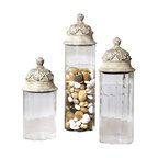 Uttermost Acorn Glass Cylinder Canisters, Set/3 - Clear glass cylinders topped with textured brown lids with a heavy tan glaze. Clear glass cylinders topped with textured brown lids with a heavy tan glaze. Not recommended for food storage. Sizes: sm-6x14x6, med-6x18x6, lg-6x21x6