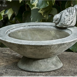 Campania International - Campania International Songbirds Rest Cast Stone Bird Bath - B-140-AL - Shop for Garden Bird Baths from Hayneedle.com! About Campania InternationalEstablished in 1984 Campania International's reputation has been built on quality original products and service. Originally selling terra cotta planters Campania soon began to research and develop the design and manufacture of cast stone garden planters and ornaments. Campania is also an importer and wholesaler of garden products including polyethylene terra cotta glazed pottery cast iron and fiberglass planters as well as classic garden structures fountains and cast resin statuary.Campania Cast Stone: The ProcessThe creation of Campania's cast stone pieces begins and ends by hand. From the creation of an original design making of a mold pouring the cast stone application of the patina to the final packing of an order the process is both technical and artistic. As many as 30 pairs of hands are involved in the creation of each Campania piece in a labor intensive 15 step process.The process begins either with the creation of an original copyrighted design by Campania's artisans or an antique original. Antique originals will often require some restoration work which is also done in-house by expert craftsmen. Campania's mold making department will then begin a multi-step process to create a production mold which will properly replicate the detail and texture of the original piece. Depending on its size and complexity a mold can take as long as three months to complete. Campania creates in excess of 700 molds per year.After a mold is completed it is moved to the production area where a team individually hand pours the liquid cast stone mixture into the mold and employs special techniques to remove air bubbles. Campania carefully monitors the PSI of every piece. PSI (pounds per square inch) measures the strength of every piece to ensure durability. The PSI of Campania pieces is currently engineered at approximately 7500 for optimum strength. Each piece is air-dried and then de-molded by hand. After an internal quality check pieces are sent to a finishing department where seams are ground and any air holes caused by the pouring process are filled and smoothed. Pieces are then placed on a pallet for stocking in the warehouse.All Campania pieces are produced and stocked in natural cast stone. When a customer's order is placed pieces are pulled and unless a piece is requested in natural cast stone it is finished in a unique patinas. All patinas are applied by hand in a multi-step process; some patinas require three separate color applications. A finisher's skill in applying the patina and wiping away any excess to highlight detail requires not only technical skill but also true artistic sensibility. Every Campania piece becomes a unique and original work of garden art as a result.After the patina is dry the piece is then quality inspected. All pieces of a customer's order are batched and checked for completeness. A two-person packing team will then pack the order by hand into gaylord boxes on pallets. The packing material used is excelsior a natural wood product that has no chemical additives and may be recycled as display material repacking customer orders mulch or even bedding for animals. This exhaustive process ensures that Campania will remain a popular and beloved choice when it comes to garden decor.Please note this product does not ship to Pennsylvania.