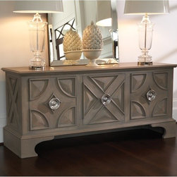 Westmoreland Cabinet - This cabinet provides a ton of storage with high style. It sits upon an oversized base allowing the floor to show beneath, and its round handles are the perfect finishing touch. Use it as a buffet in the dining room, as media storage, as a credenza in your home office or perhaps for clothing stroage in the bedroom.