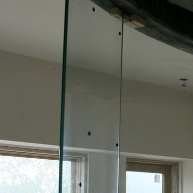 Frameless Shower Enclosures - A side view of the bent tempered glass - A & D Glass Inc.