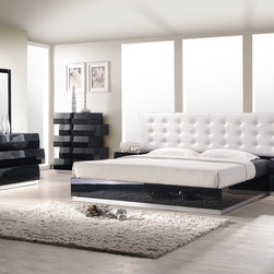 J&M Furniture - J&M Furniture Milan 5 Piece Platform Bedroom Set in Black Lacquer - Milan Bedroom by J&M Furniture offers a fresh aim and outlook of the modern bedroom. Uniquely designed case goods reminiscent of Lego blocks  this black lacquered finish set will enhance the look of bedrooms of different sizes and colors. The white leatherette headboard provides elegance as well as a classic look to the bedroom set. Whether choosing the entire set  its individual platform bed  or any of the case goods  you can rest assured that this quality furniture is meant to last. Our case goods are equipped with full extension glides  and are built with plantation grown solid wood.