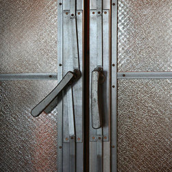 Canal Street Residence - Hot rolled steel and wire glass vestibule doors with hand forged cane bolt locks.