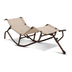None - Easy Outdoor Rocking Lounge Chair - Relax in a comfortable chair while enjoying the sun's blissful rays with this rocking lounge chair. Featuring a woven fabric to keep your body cool, this chair's unique design evenly distributes your weight and improves your body's circulation.
