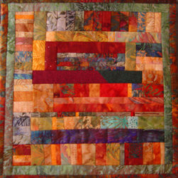 Remains Of The Day #3 Wall Art Quilt (Original) by Connie Betterley - For every large quilt that I make, I end up with an assortment of fabric strips and bits of fabric.  I enjoy sewing these into smaller wall art pieces that have a new configuration from the original and yet are related.  This unique wall quilt is made from the remains from three larger bargello quilts. This one-of-a-kind art quilt is crafted out of cotton batik fabrics and is delivered ready to hang in a special place in your home or office.