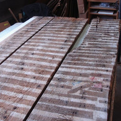 Nantucket reclaimed lumber heart pine counter top - Here is a photo of several reclaimed heart pine boards removed from a cottage on Nantucket Island. The boards had been previously used for walls.