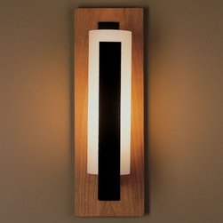 Hubbardton Forge - Forged Vertical Bars Outdoor Wall Sconce-Damp by Hubbardton Forge - The Hubbardton Forge Forged Vertical Bars Outdoor Wall Sconce-Damp is a charismatic lighting fixture that adds warmth to your exterior decors and provides an inviting illumination. The Forged Vertical Bars Outdoor Wall Sconce-Damp features a hand-blown glass shade and forged aluminum construction.Hubbardton Forge, headquartered in Hubbardton, Vermont, hand-forges simple and elegant metal lighting fixtures and accessories, combining ancient hand-forging techniques with environmentally-sound finishing practices.The Hubbardton Forge Forged Vertical Bar Outdoor Wall Sconce-Damp is available with the following:Details:Hand-blown, cylindrical glass shadeFront accent vertical barsForged aluminum constructionWall plateADA CompliantUL Listed for damp locations. Install in protected, fully covered outdoor locations only. More about UL Listings.Options:Backplate: Cherry, Sierra Patina Copper, Slate, or Steel.Front Accent Vertical Bar Finish: Black, Bronze, Burnished Steel, Dark Smoke, Mahogany, or Natural Iron.Glass Color: Opal, or Stone.Lamping: Fluorescent, or Incandescent.Lighting:Fluorescent option utilizes one 13 Watt 120 Volt Type G24 Fluorescent lamp (included).Incandescent option utilizes one 100 Watt 120 Volt Type BT15 Medium Base Incandescent lamp (not included).Please Note: This item is hand-forged by master craftsmen and includes hand-blown glass. As a result, variations in finish appearance and small blemishes, bubbles, and variations in the color of the glass are a normal and desired result of handcrafted processes.Shipping:This item usually ships within 2-3 weeks.