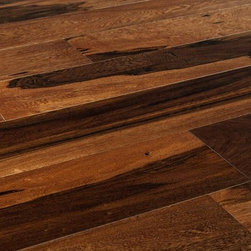 """Vanier - Vanier Engineered Hardwood - Brazilian Exotic Collection - [31.0 sq ft/box] - Brazilian Pecan Chocolate / 5 1/4"""" -  These responsibly-forested products bring the vivid richness of Brazil's incredible species to life for your space. Engineered for incredible toughness and packing a thick 3mm wear layer, these gorgeous light-, medium-, and dark-brown woods will be a stunning focal point in any environment.  South American exotic woods are known for their rich colors and their amazing longevity. The appeal of these species has stood the test of time and will endure for many, many years.  Opulent and lush engineered hardwood flooring  While Brazilian Walnut and Pecan have been long favored for their opulent, lush tones, but ��_they've long been unstable for engineered flooring, until now.   With cutting-edge engineering, a sturdy 3mm wear layer, and flexible installation options, these exotic hardwoods in an engineered plank in represents durable, desirable options in an engineered hardwood, presented here on the Vanier label.   Harvested & manufactured responsibly  Our manufacturing partners believe in taking the best species and using all of today's technological advances to make the best product for your space using responsible harvesting techniques. That's why they harvest these species to combine them with processes that use as much fibre as possible to minimize waste.  With responsible practices, quality products, and cutting-edge tech, it's hard not to see the appeal of these beautiful floors.  Quality and pricing you can count on  At BuildDirect, we know floors. We also know you want the great results you'll get to last for years, and even decades. That's why don't never cut corners to save you money, because that's only half the job -- you need great quality too.  With durable engineering meant to honor the great species that provide us with these rich, beautiful floors, industry experts have partnered wi"""
