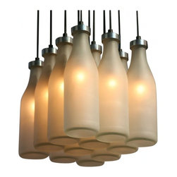 Droog - Milk Bottle Chandelier by Tejo Remy - Milk your decor! This inventive fixture repurposes a dozen glass bottles into stunning shades to bring a warm, nostalgic feel to your favorite setting.