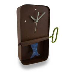 Blue Sardine Can Wall Clock Sardine Pendulum - This adorable clock combines a cute crafty design with timekeeping utility for a remarkable collectible time piece. Hand crafted from recycled metal materials, the clock takes on a uniquely artistic shape as an old rusted sardine tin. The body of the tin forms the clock face for a quartz clock movement with a sardine-shaped pendulum swinging within the tin. The clock runs on 1 AAA battery (not included). A modest hand-painted finish completes the feel of home-style craftwork. The clock measures 9 inches tall, 6 1/2 inches wide, and 2 1/2 inches deep. It may hang on the wall by the top lid of the sardine can. This piece makes a unique crafty home accent as a useful, decorative timepiece.