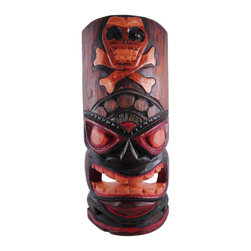11 Inch Skull And Crossbones Tiki Wall Mask Hand Painted - This awesome, angry looking tiki wall mask is hand-carved from Indonesian Albessia wood, and hand-painted to show off the detail. It features a carved skull and crossbones at the top and a big grimace on the face of the idol. Measuring 11 1/2 inches tall, 4 3/4 inches in wide, it looks great outdoors in patios and tiki bars, or indoors in dens and living rooms. This wall hanging makes a great gift for friends and family. NOTE: Since these are hand carved and hand painted, there may be slight color or facial differences from the pictures.
