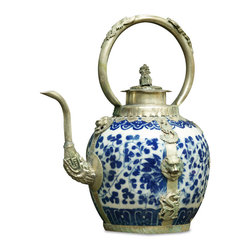 China Furniture and Arts - Tibetan Porcelain and Brass Teapot - Teapots and kettles are considered livelihood necessities in Tibet. As such, our unique decorative Tibetan teapots are a gorgeous representation of Tibetan culture and history. A lovely addition to your collection, this particular tea pot features a hand painted traditional blue and white porcelain body with intricate brass dragons and phoenixes ornamenting the sides. Forged with great detail, a lone foo dog stands guard atop the pot's lid. Intended as a decorative item only. Not recommended for beverage storage or preparation.