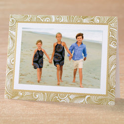 """Exposures - Graceful Greetings Photo Christmas Card Set of 18 - Overview Stylish and playful, the scrolling design and golden embossed border make a lovely presentation for your holiday photo. Our exclusive photo cards are the perfect way to stay in touch and share a smile with family and friends during the holiday season Features:  Pre-printed interior verse: """"Wishing you a season of peace  Wishing you a season of happiness."""" Premium white card stock with a textured finish Foil and embossed details Set of 18 photo mount cards Designed to accommodate either horizontal or vertical photos Includes adhesive dots to attach your photo Includes 20 coordinating gold foil-lined white envelopes Includes free gold foil envelope seals to add a special finishing touch   Personalization  Card personalization available in a coordinating color and font, imprinted below the pre-printed verse; up to 3 lines, 50 characters per line  Select horizontal or vertical placement to match orientation of your photo  Envelope personalization available in a coordinating color and font, imprinted on the back flap of the envelope; up to 3 lines, 48 characters per line   Specifications  Folded card size 8"""" wide x 6"""" high Holds one horizontal or vertical 4"""" x 6"""" photo   Shipping  Please allow an additional 2 weeks for imprinted items No returns on personalized items unless the item is damaged or defective"""
