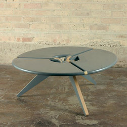 New Breed Round Coffee Table - A coffee table dinner needs a coffee table. How about this one that, when not used for nefarious purposes, is a perfectly innocent mid-century modern piece?