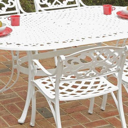 HomeStyles - Outdoor Oval Dining Table - Top designed specifically to prevent damage caused from pooling by allowing water to pass through freely. Adjustable, nylon glides prevent damage to surfaces caused by movement and provide stability on uneven surfaces. Stainless steel hardware. Made from cast aluminum. UV resistant powder coated white finish. 72 in. L x 42 in. W x 29 in. H. Warranty. Assembly InstructionsHome styles outdoor dining collection gives you the beauty of ornately designed pieces without the high cost.