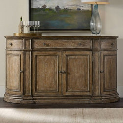 Hooker Furniture - Hooker Furniture Solana 4-Door Dining Buffet - Natural Multicolor - 5291-75900 - Shop for Buffets and Side Boards from Hayneedle.com! A casually elegant choice for stashing your dining room essentials the Hooker Furniture Solana 4-Door Dining Buffet - Natural features a curved front and distressed natural finish. Three drawers include a drop front center drawer. Of the four cupboard doors the left and right side swing out to reveal one adjustable shelf behind each. Reversible wine storage shelf behind the center pair of doors holds 10 bottles. This dining buffet is made of poplar solids and oak veneers with a distressed natural wood finish and custom knobs.About Hooker Furniture CorporationFor 83 years Hooker Furniture Corporation has produced high-quality innovative home furnishings that seamlessly combine function and elegance. Today Hooker is one of the nation's premier manufacturers and importers of furniture and seeks to enrich the lives of customers with beautiful trouble-free home furnishings. The Martinsville Virginia based company specializes in lifestyle driven furnishings like entertainment centers home office furniture accent tables and chairs.Construction of Hooker FurnitureHooker Furniture chooses solid woods and select wood veneers over wood frames to construct their high-quality pieces. By using wood veneer pieces can be given a decorative look that can't be achieved with the use of solid wood alone. The veneers add beautiful accents of color and design to the pieces and are placed over engineered wood product for strength. All Hooker wood veneers are made from renewable resources and are located primarily on the flat surfaces of the furniture such as the case tops and sides.Each Hooker furniture piece is finished using up to 30 different steps including 13 steps of hand-sanding and accenting. Physical distressing is done by hand. Pieces receive two to three coats of solid lacquer to create extra depth and add durability to the fin