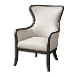 Uttermost - Sandy Wing Back Armchair - So chic, with subtle shimmer. This impeccable armchair has a solid wood frame with weathered finish and brass nailhead details to bring the ultimate in elegance to your dining room or living area.