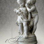 """Artisan Sculpture - Romantic sculpture depicting Cupid whispering to a shy young girl as she walks barefoot in the garden carrying a bouquet of just-picked wildflowers. After the work of French sculptor Auguste Moreau, Paris circa 1880. Individually handcrafted in high quality plaster with an antique hand painted finish. 20"""" tall."""