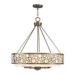 Livex Avalon 8678-64 Chandelier - Palatial Bronze with Gilded Accents - 26W in. - The most obvious quality that makes the Livex Avalon 8678-64 Chandelier - Palatial Bronze with Gilded Accents - 26W in. stand out among other lighting fixtures is the perfect balance it strikes between classic elegance and contemporary appeal. Finished in palatial bronze with gilded accents, the frame features circular cut-outs, which play up the beauty of the drum-shaped, silk champagne hardback shade as it diffuses warm, ambient light to brighten up your foyer or dining nook. Boasting graceful curves, fluidity of design, and upscale transitional appeal, this 26-inch chandelier uses eight 60-watt candelabra base bulbs (not included), while 36 inches of chain and 120 inches of wire make installation a breeze.About Livex LightingLivex Lighting is a manufacturer and distributor of decorative residential lighting. The company was founded in 1993 and is now headquartered in a 150,000-square-foot facility in Morristown, New Jersey. Livex Lighting currently offers over 2,500 products ranging from lighting fixtures for indoor and outdoor applications to lampshades, chandelier shades, ceiling medallions, and accent furniture. The goal of Livex Lighting is to provide the highest-quality product at the most affordable price. We are constantly responding to the ever-changing needs, styles, and fashions of the lighting industry while always maintaining the highest standards of quality.