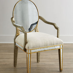 John-Richard Collection Lela Eglomise Armchair - Dining chairs from the John-Richard Collection are handcrafted of acacia wood with a gilded pewter finish, polyester/acrylic upholstery, and gilded eglomise glass. Chair backs have a wheel design on the reverse