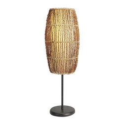 ORE International - Accent Table Lamp w Natural Woven Rattan Oute - Requires 1 60W bulb (bulb not included). On and off switch . Rattan weave shade. Linen inner shade in parchment finish. Round Black metal base . Brown and Black finish. 7 in. L x 7 in. W x 31.5 in. H (5 lbs.)This casual design offers a finely-crafted look. Add this accent lamp to end tables, a buffet, or anywhere to complement your comfortable decor. Warm and inviting with a casual, island inspired appeal, this slender table lamp will bring a relaxed spirit to your home's decor.