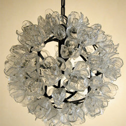 "Elizabeth Lyons Glass Magnolia Chandelier - This sublime chandelier from Atlanta glass artist Elizabeth Lyons gives new meaning to ""Steel Magnolias""! Sixty glass flowers suround a steel globe to light up your room with artful beauty."
