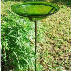 Minuteman International - 12 in. Crackled Glass Bird Bath - GBB-01 - Shop for Decorative Bowls and Vases from Hayneedle.com! Set up a spot where the birds can get a cool respite by using the 12 in. Crackled Glass Bird Bath. With a crackle glass construction this basin can easily blend in with almost all outdoor settings. Available in a series of attractive hues you can choose your favorite color. It includes a Roman bronze cradle and a stake which adds to its visual appeal and functionality. Made of high quality glass this bird bath will last for years. About ACHLA DesignsThis item is created by ACHLA Designs. ACHLA is a garden accessories company that emphasizes unique wood and hand-forged wrought iron European furnishings for the home and garden. ACHLA Designs continues to add beautiful and unique items year after year resulting in an unusually large product line. All ACHLA products are stocked in the company's warehouse for year-round prompt shipping. ACHLA Designs takes great pride in offering exceptional products and customer service.