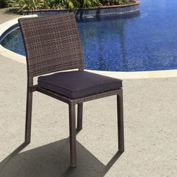 Liberty All-Weather Wicker Patio Dining Side Chair - Set of 4 - Calling it a side chair might make the Liberty All-Weather Wicker Patio Dining Side Chair - Set of 4 seem kind of like a peripheral piece of furniture, but let us assure you, the only side this chair is on is yours. Those clean lines and the simple color scheme are designed to look good for years, thanks to the frame of rust-proof aluminum that's covered by resin wicker. Just think of it as wicker's hip nephew, as this robust, synthetic material gives you the look and texture of traditional wicker while still being resistant to moisture, weathering and rot. The square-bound cushion is covered in your choice of fabrics and also designed to spend its life outdoors while giving you a comfy place to sit.