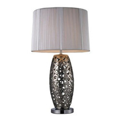 Dimond D1446 Varick Table Lamp - The Dimond D1446 Varick Table Lamp is playful and creative. Circles abound, making up the ceramic body finished in Alisa Silver. The large drum shade is wrapped in streaked white fabric for a diffuse, clean glow. Set the mood with the 3-way on/off switch. Uses one standard medium base 3-way 150-watt bulb (not included). This lamp makes us smile.About DimondThe newest member of the E.L.K. Lighting family, Dimond Lighting was founded with the same commitment to delivering quality products with designer appeal and conscientious value. They're proud to present a comprehensive product driven by emerging fashion and industry-leading trends. Their award-winning team of international designers and engineers ensures that each product is created with uncompromising detail and unparalleled design. Dimond Lighting creations truly become Jewelry for the Home.Please note this product does not ship to Pennsylvania.