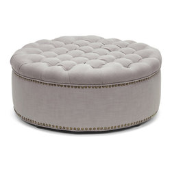 "Baxton Studio - Baxton Studio Iglehart Beige Linen Modern Tufted Ottoman - A cut above the rest: the Iglehart Designer Ottoman will exceed your expectations. This beautiful living area centerpiece is made in China with a sturdy eucalyptus wood frame, firm foam cushioning, and beige linen upholstery. Finishing touches include antiqued brass upholstery tacks and black wood legs with non-marking feet. The Iglehart Round Ottoman is fully assembled and should be spot cleaned as needed. This style is also available in dark slate gray (sold separately). 37.4""W x 37.4""D x 15.25""H"